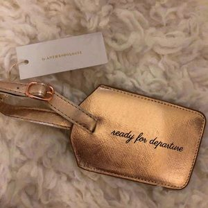 Anthropologie luggage tag